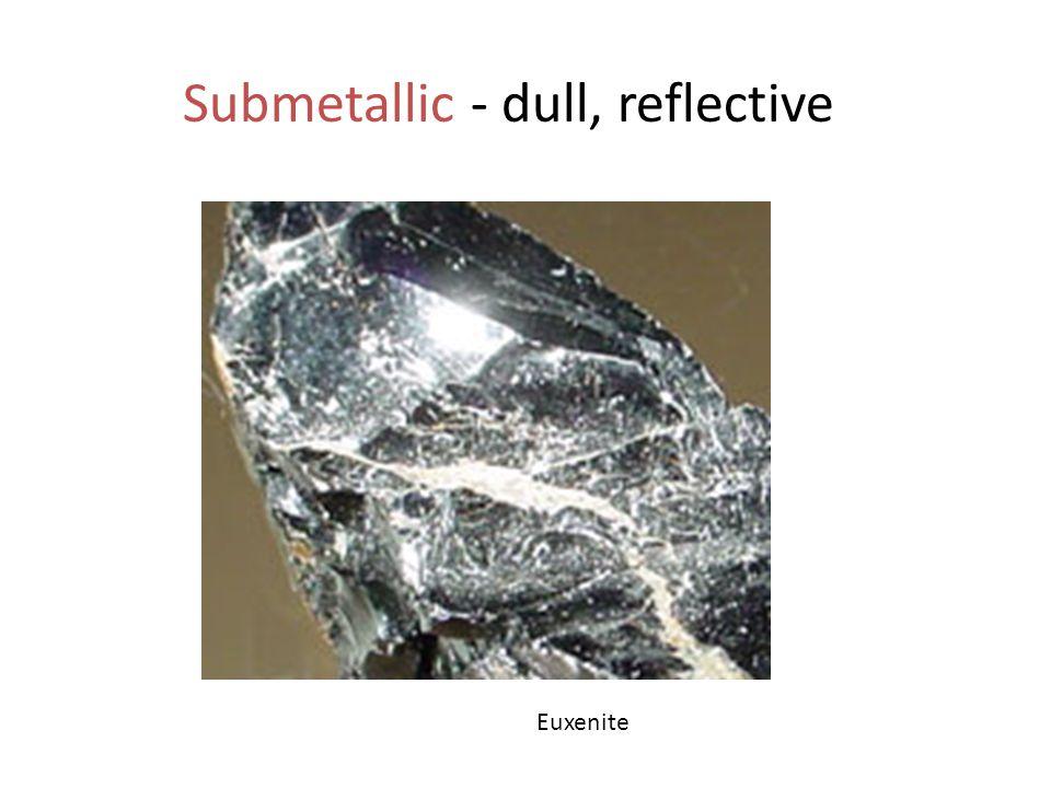 Submetallic - dull, reflective Euxenite