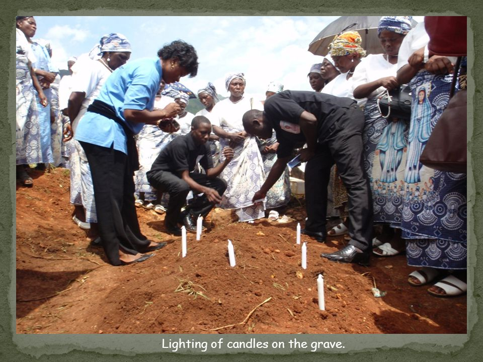 Lighting of candles on the grave.