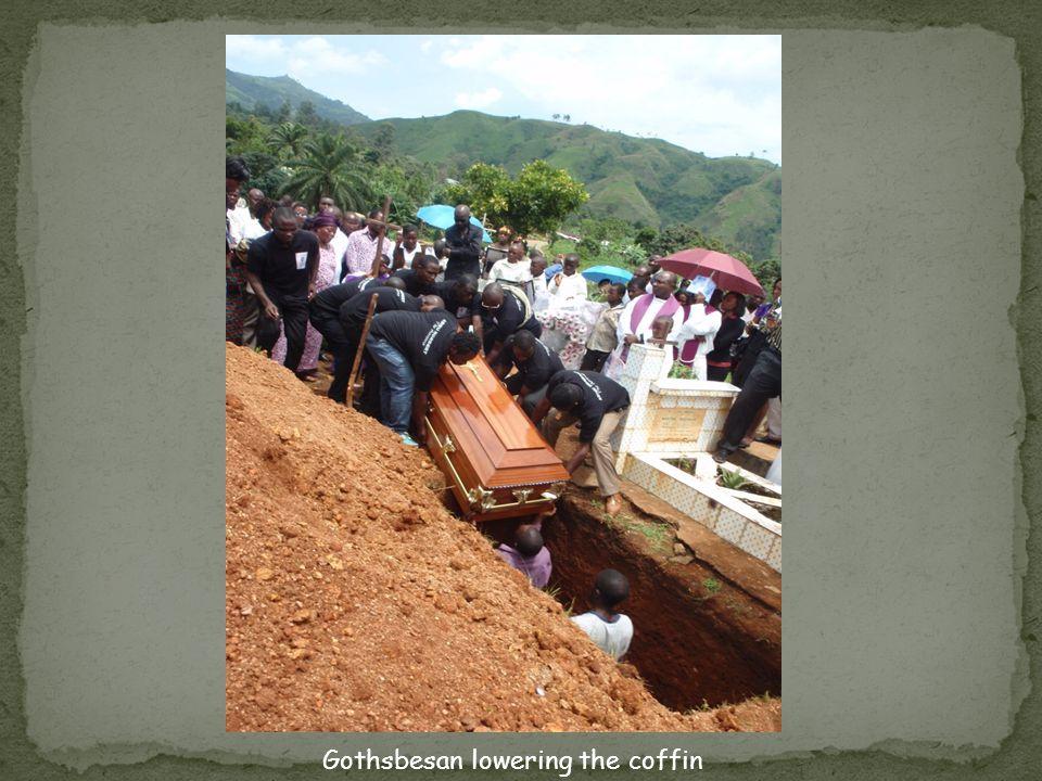 Gothsbesan lowering the coffin
