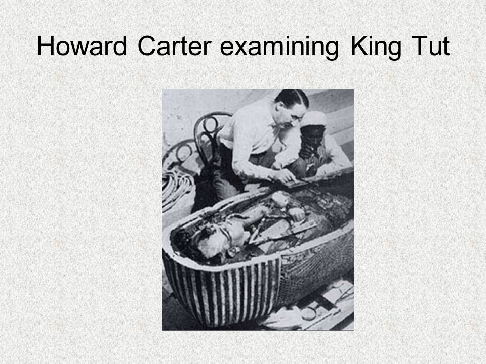 Howard Carter examining King Tut