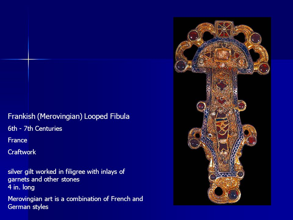Frankish (Merovingian) Looped Fibula 6th - 7th Centuries France Craftwork silver gilt worked in filigree with inlays of garnets and other stones 4 in.