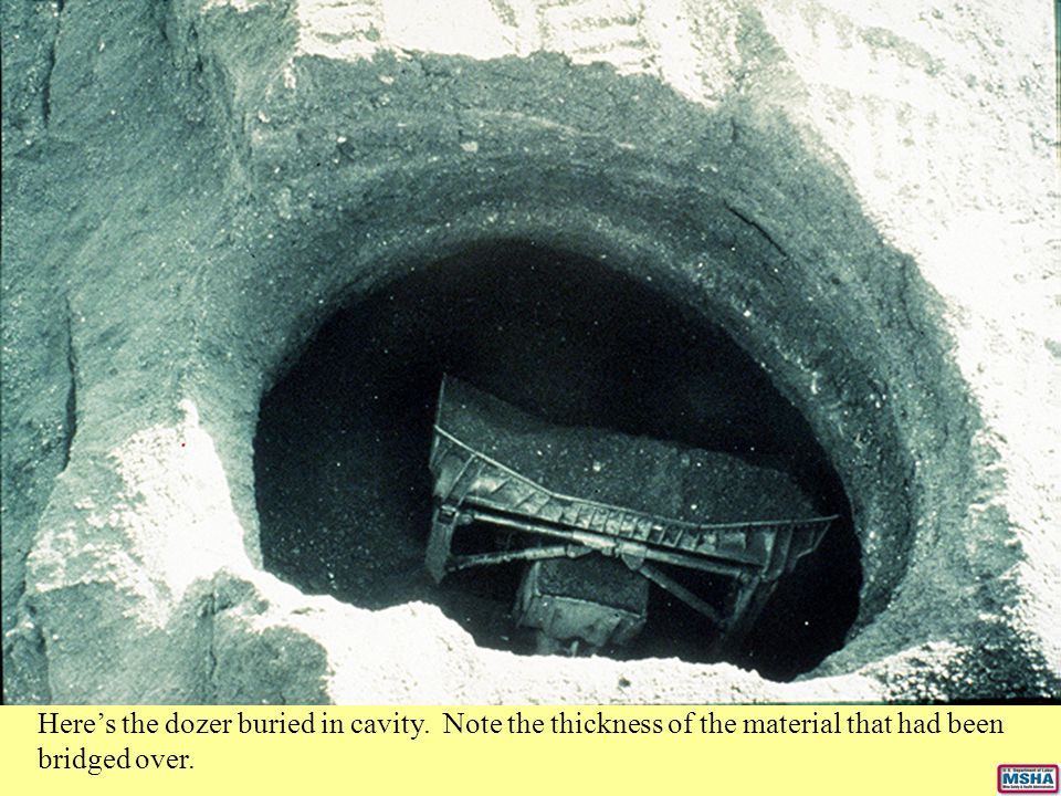 Here's the dozer buried in cavity. Note the thickness of the material that had been bridged over.