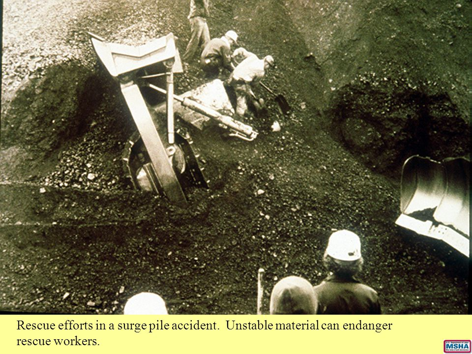 Rescue efforts in a surge pile accident. Unstable material can endanger rescue workers.