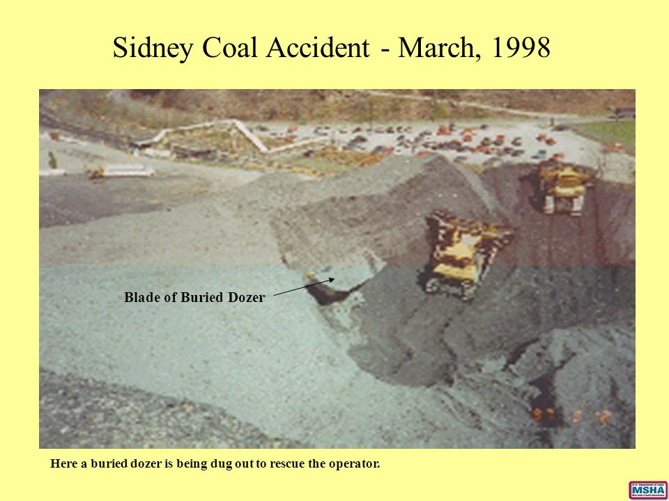 Sidney Coal Accident - March, 1998 Here a buried dozer is being dug out to rescue the operator. Blade of Buried Dozer