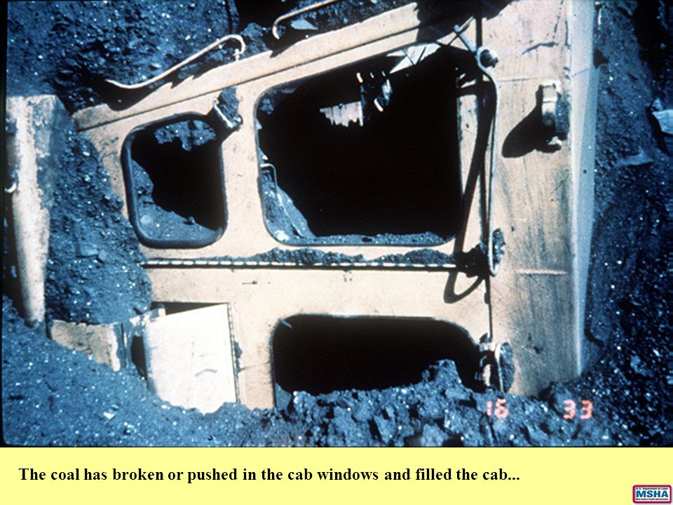 The coal has broken or pushed in the cab windows and filled the cab...