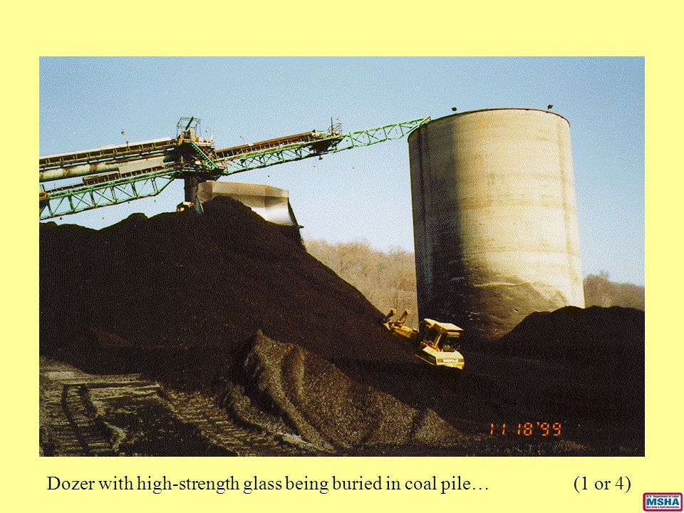 Dozer with high-strength glass being buried in coal pile… (1 or 4)