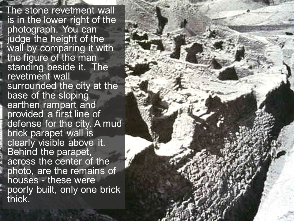 The stone revetment wall is in the lower right of the photograph. You can judge the height of the wall by comparing it with the figure of the man stan