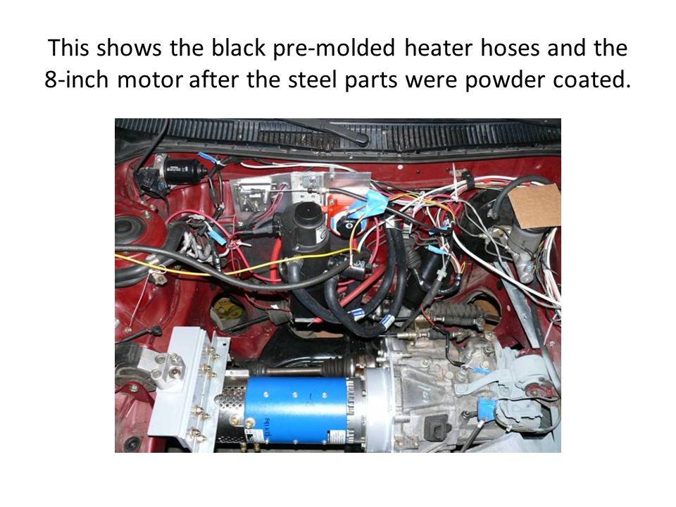 This shows the black pre-molded heater hoses and the 8-inch motor after the steel parts were powder coated.