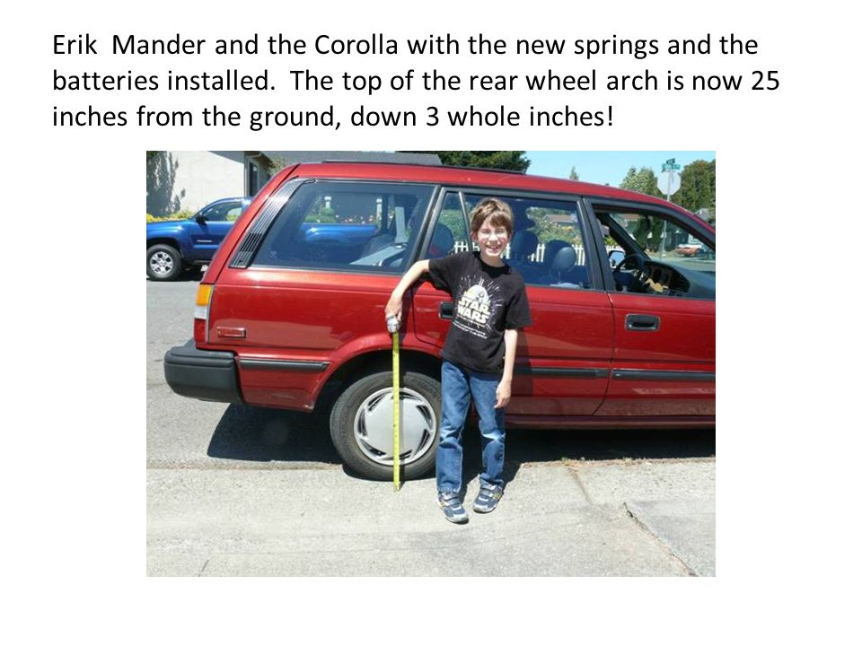 Erik Mander and the Corolla with the new springs and the batteries installed.