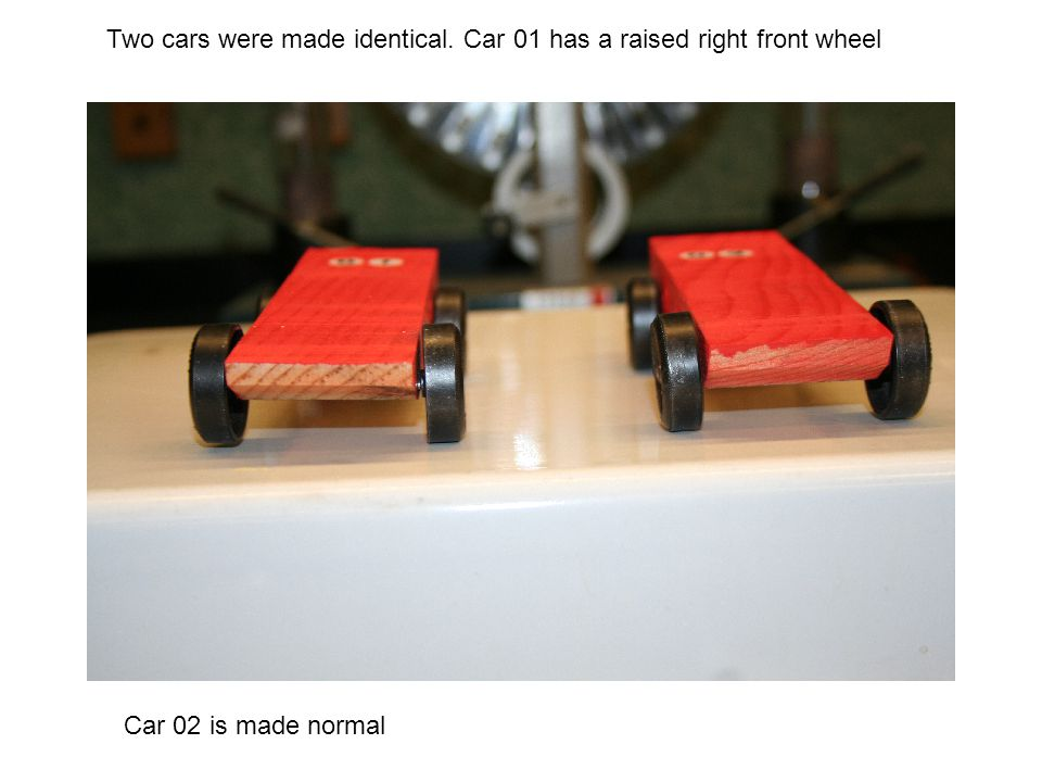 Two cars were made identical. Car 01 has a raised right front wheel Car 02 is made normal