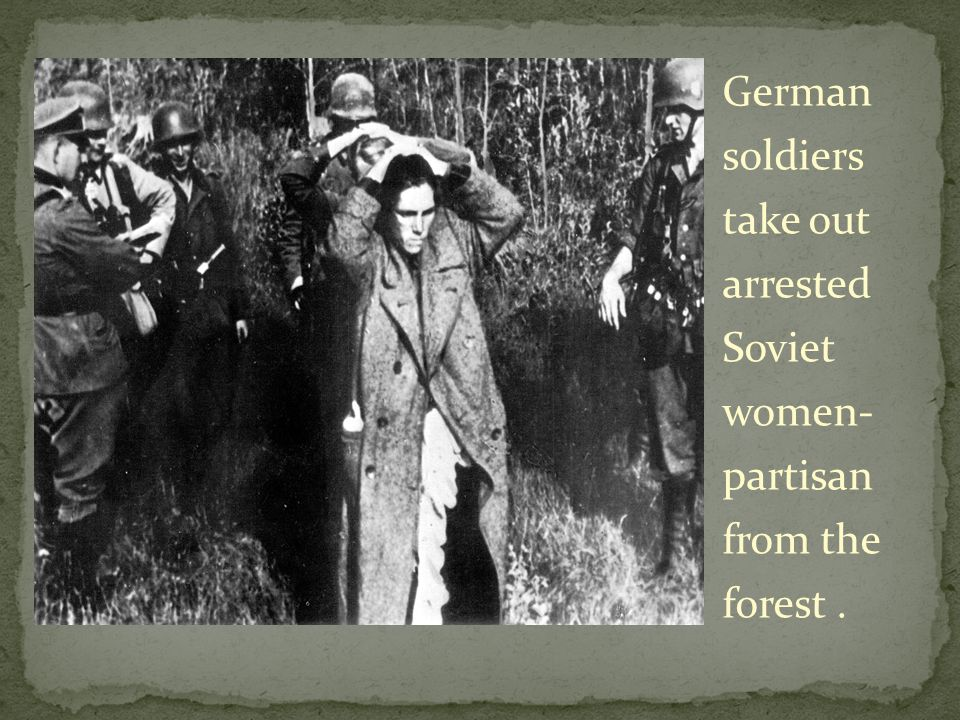 German soldiers take out arrested Soviet women- partisan from the forest.