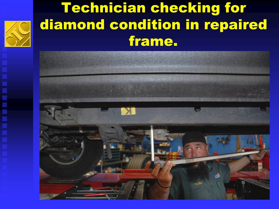 Technician checking for diamond condition in repaired frame.