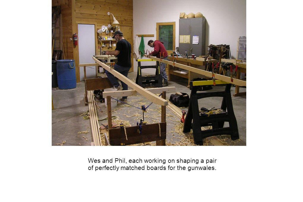 Wes and Phil, each working on shaping a pair of perfectly matched boards for the gunwales.