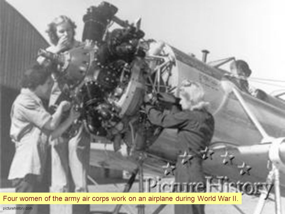 picturehistory.com Four women of the army air corps work on an airplane during World War II.