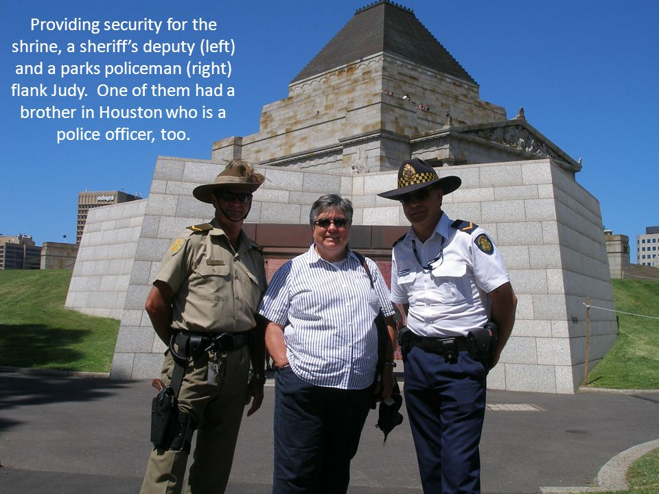 Providing security for the shrine, a sheriff's deputy (left) and a parks policeman (right) flank Judy.