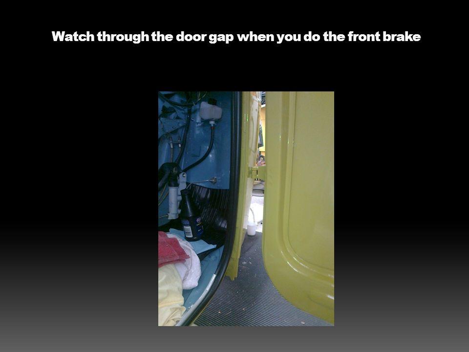 Watch through the door gap when you do the front brake
