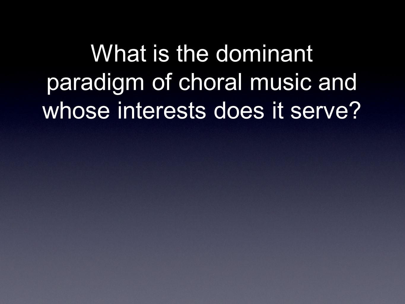 What is the dominant paradigm of choral music and whose interests does it serve
