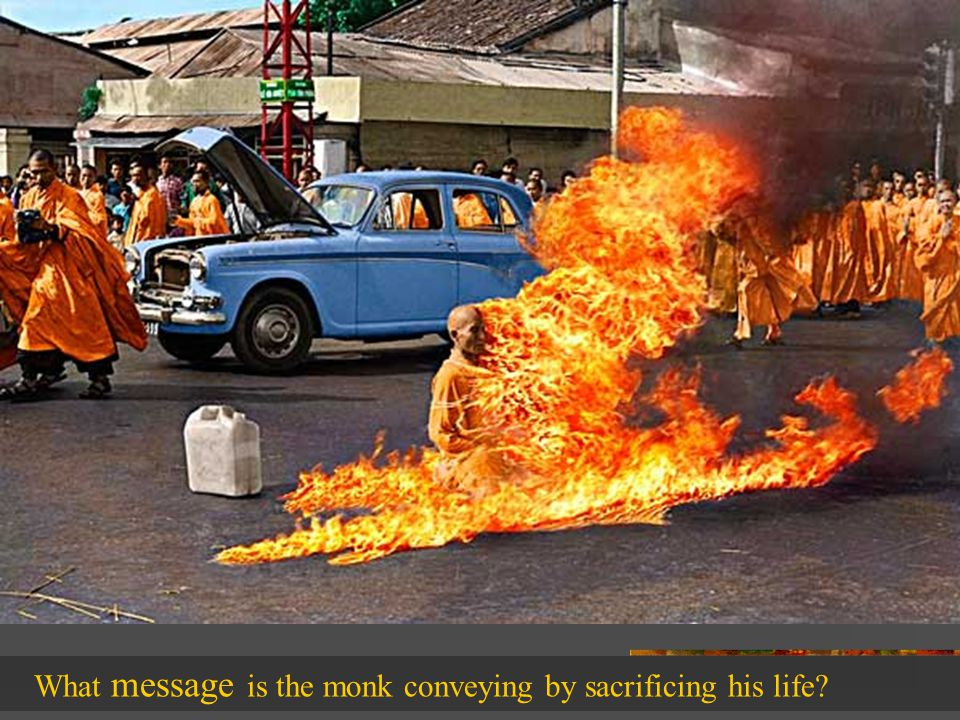 What message is the monk conveying by sacrificing his life
