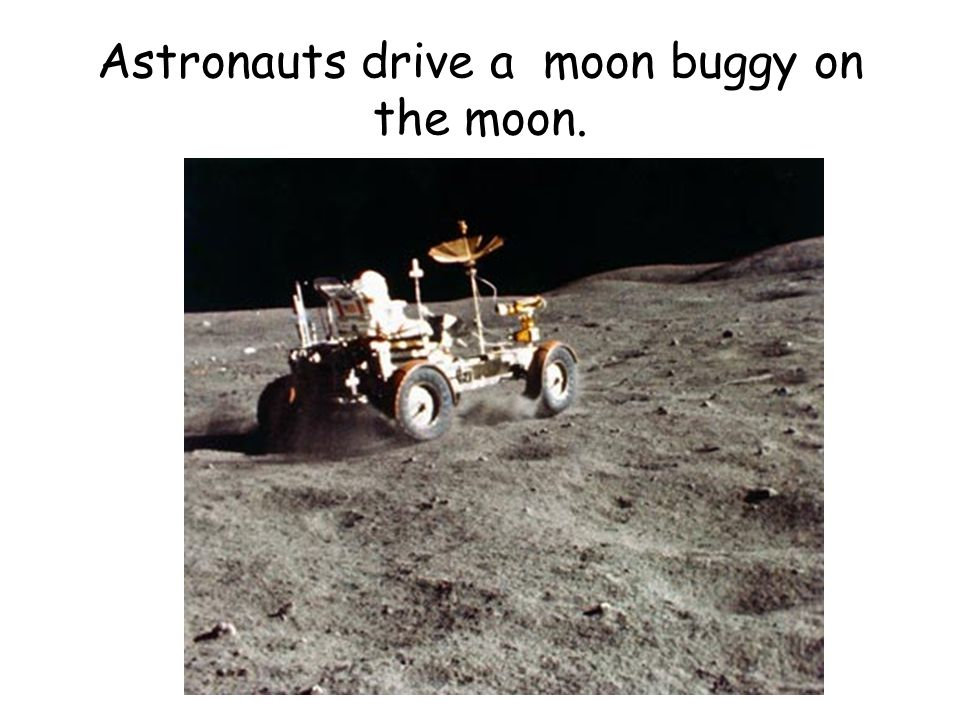 Astronauts drive a moon buggy on the moon.
