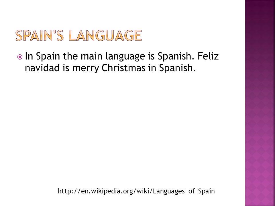  In Spain the main language is Spanish. Feliz navidad is merry Christmas in Spanish. http://en.wikipedia.org/wiki/Languages_of_Spain