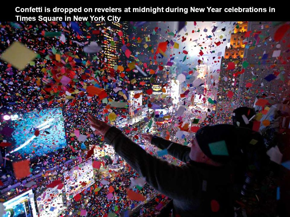 Revelers celebrate the New Year on the Champs Elysees avenue in Paris.