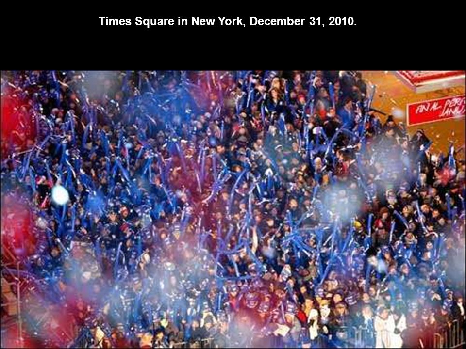 Confetti is dropped on revelers at midnight during New Year celebrations in Times Square in New York City