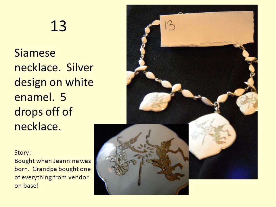 13 Siamese necklace. Silver design on white enamel.