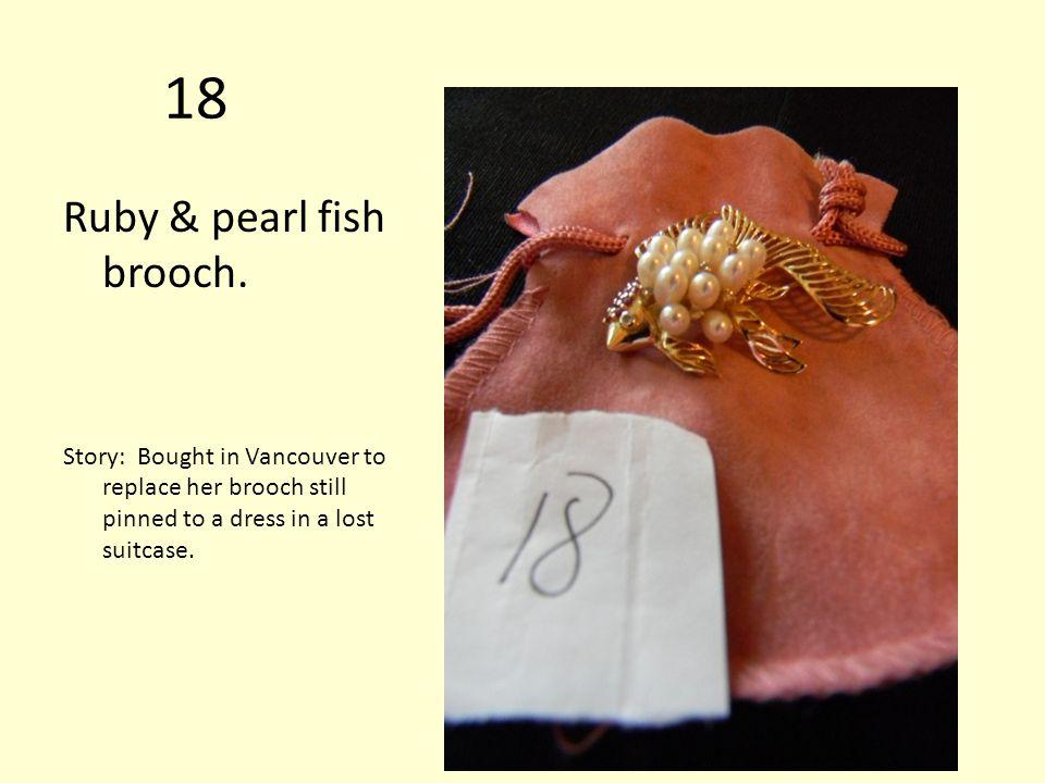 18 Ruby & pearl fish brooch.