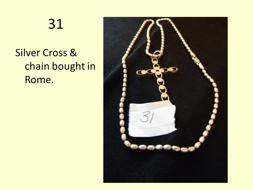 31 Silver Cross & chain bought in Rome.
