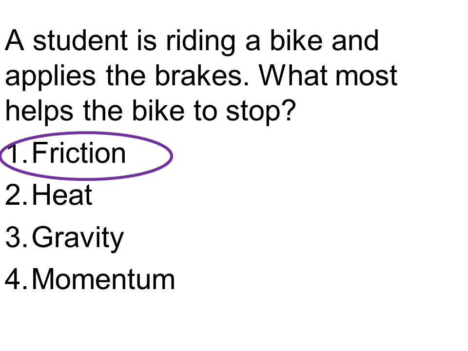 A student is riding a bike and applies the brakes.