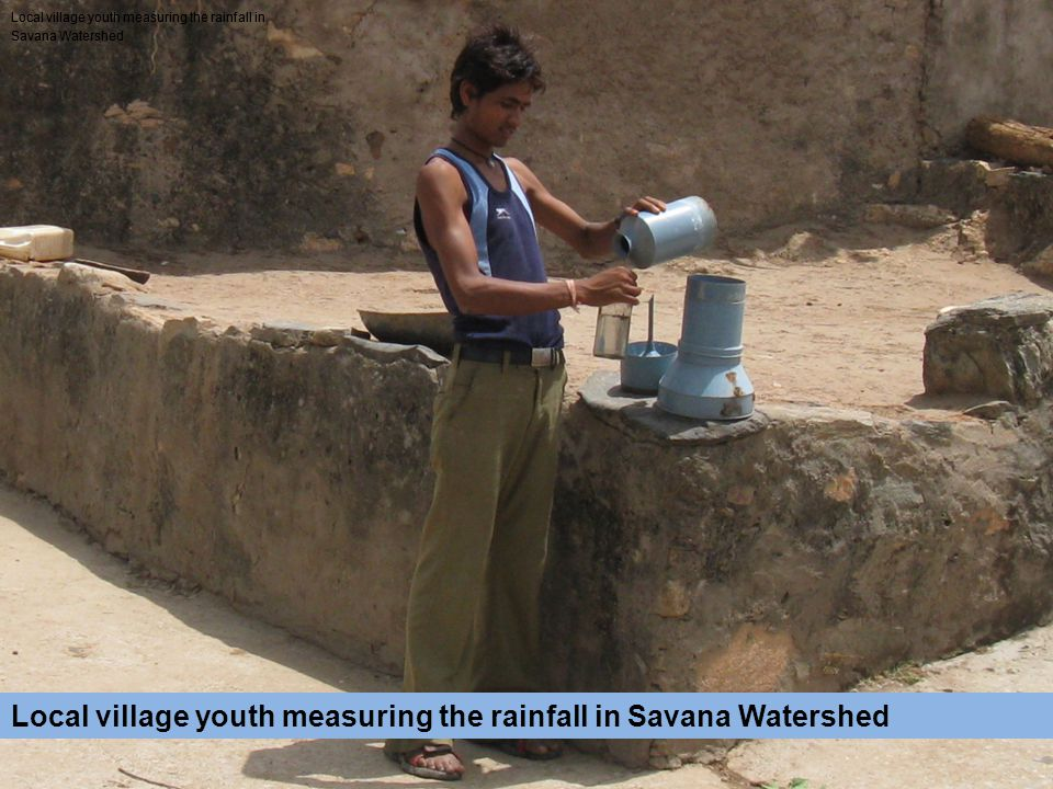 Local village youth measuring the rainfall in Savana Watershed Local village youth measuring the rainfall in Savana Watershed Local village youth measuring the rainfall in Savana Watershed