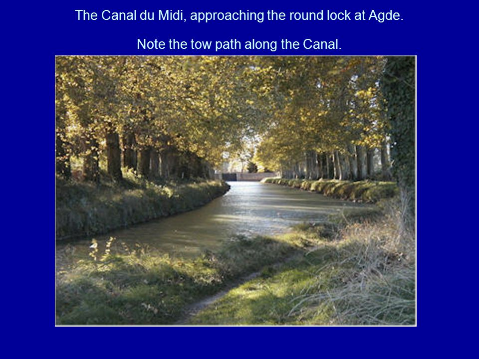 The Canal du Midi, approaching the round lock at Agde. Note the tow path along the Canal.