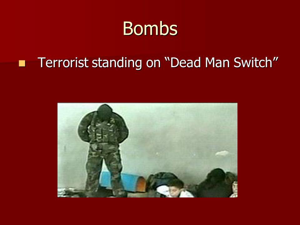 Bombs Terrorist standing on Dead Man Switch Terrorist standing on Dead Man Switch
