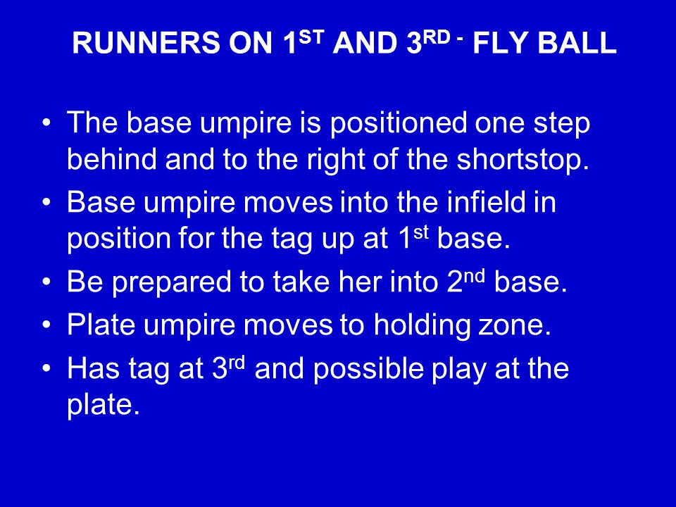 RUNNERS ON 1 ST AND 3 RD - FLY BALL The base umpire is positioned one step behind and to the right of the shortstop.
