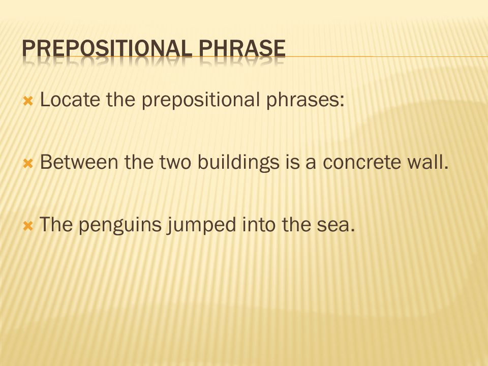  Locate the prepositional phrases:  Between the two buildings is a concrete wall.