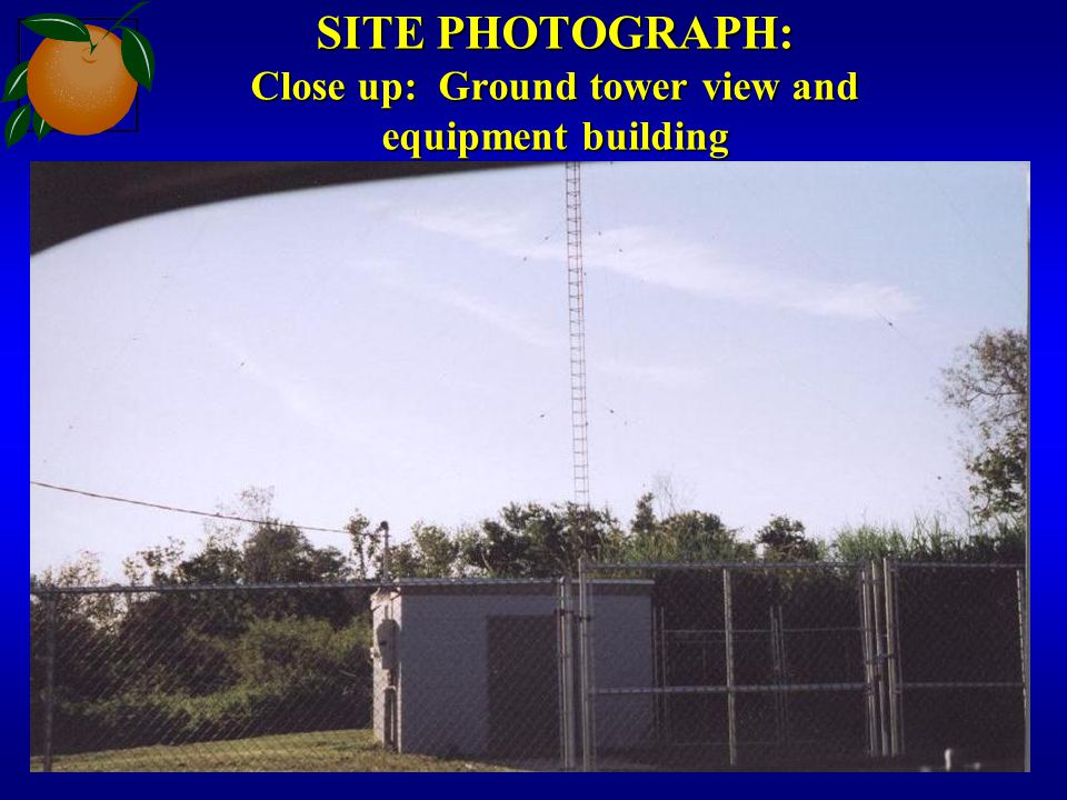 SITE PHOTOGRAPH: Close up: Ground tower view and equipment building