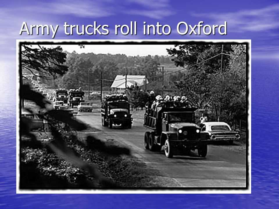 Army trucks roll into Oxford