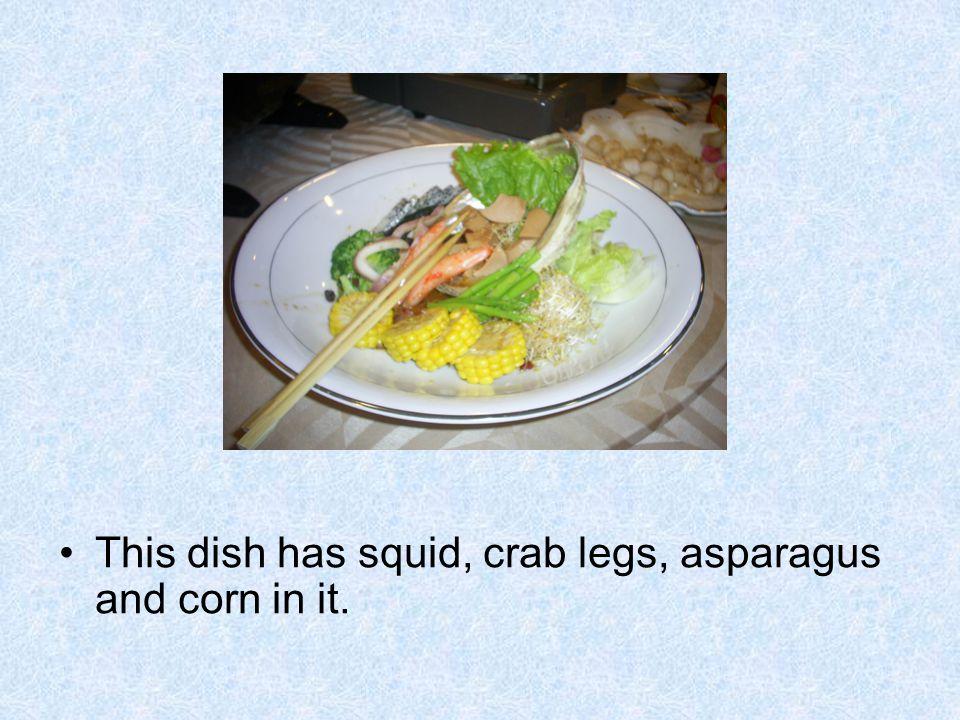 This dish has squid, crab legs, asparagus and corn in it.