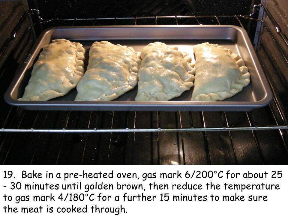 19. Bake in a pre-heated oven, gas mark 6/200°C for about 25 - 30 minutes until golden brown, then reduce the temperature to gas mark 4/180°C for a fu