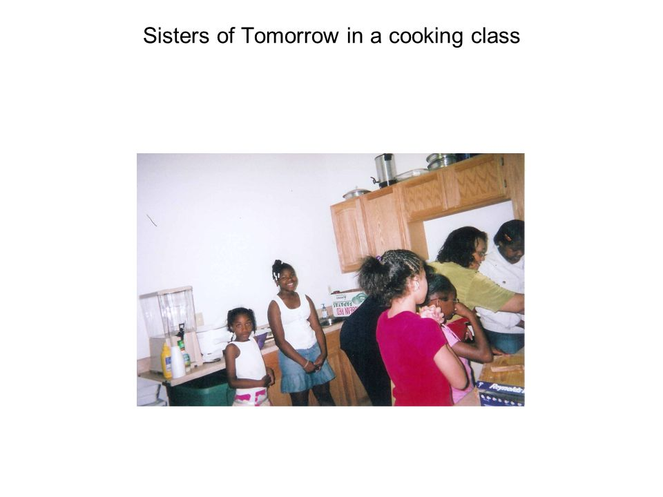 Sisters of Tomorrow learning to set a table correctly