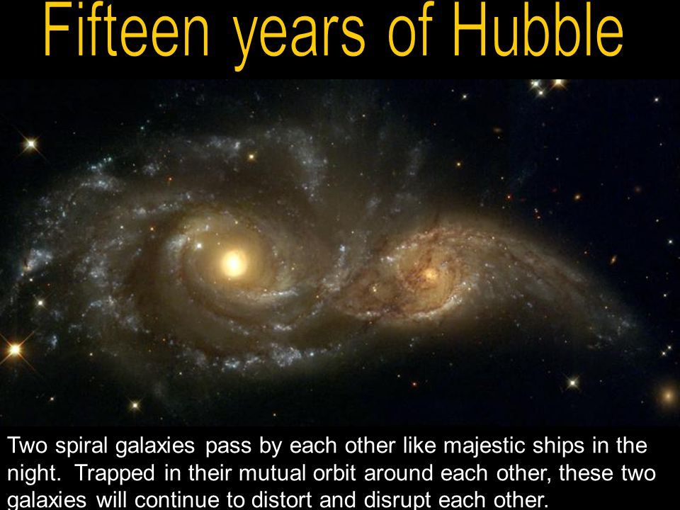Two spiral galaxies pass by each other like majestic ships in the night.