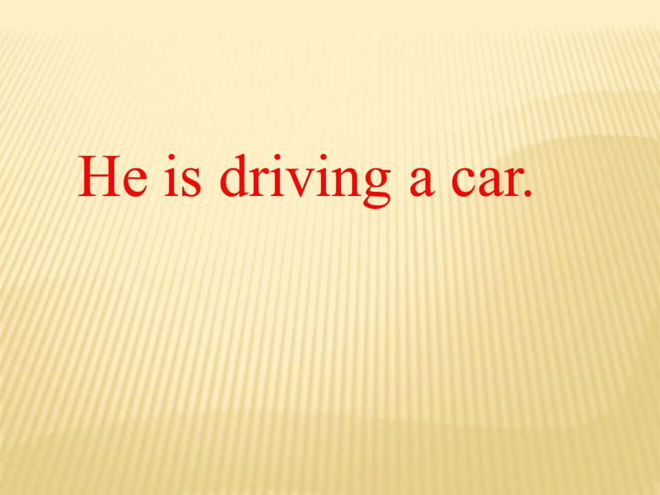 He is driving a car.