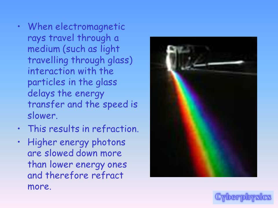 When electromagnetic rays travel through a medium (such as light travelling through glass) interaction with the particles in the glass delays the energy transfer and the speed is slower.