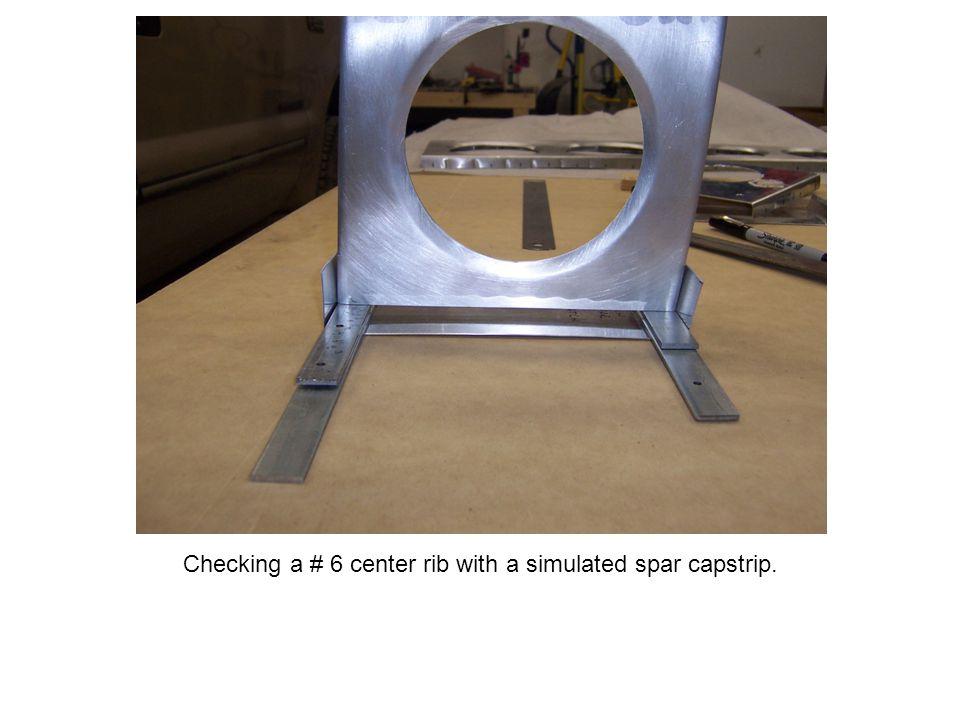 Checking a # 6 center rib with a simulated spar capstrip.