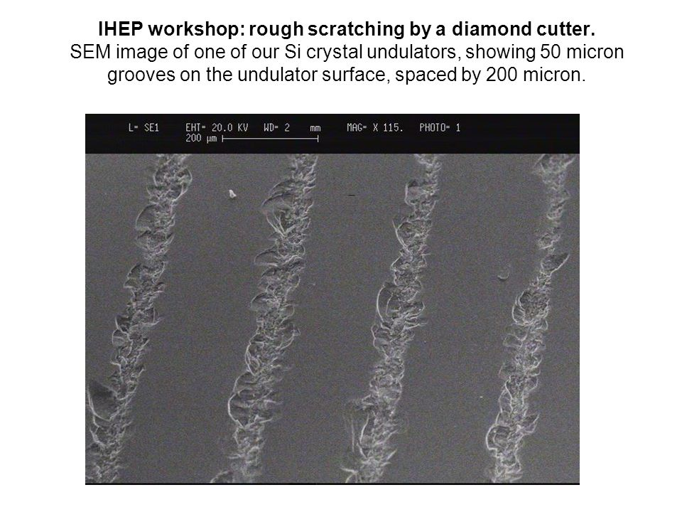 IHEP workshop: rough scratching by a diamond cutter. SEM image of one of our Si crystal undulators, showing 50 micron grooves on the undulator surface