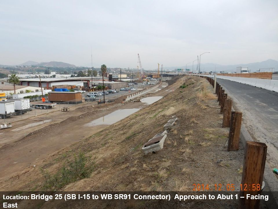 Location: Bridge 25 (SB I-15 to WB SR91 Connector) Approach to Abut 1 – Facing East Description: Retaining Wall 219 installation up to Bridge 25, Abutment 1