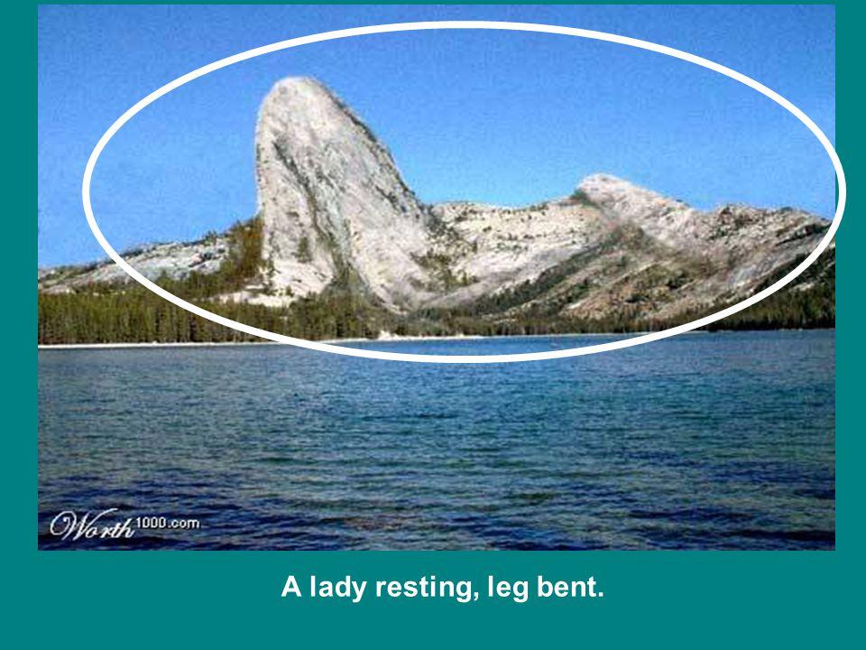 A lady resting, leg bent.