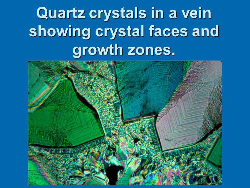 Quartz crystals in a vein showing crystal faces and growth zones.