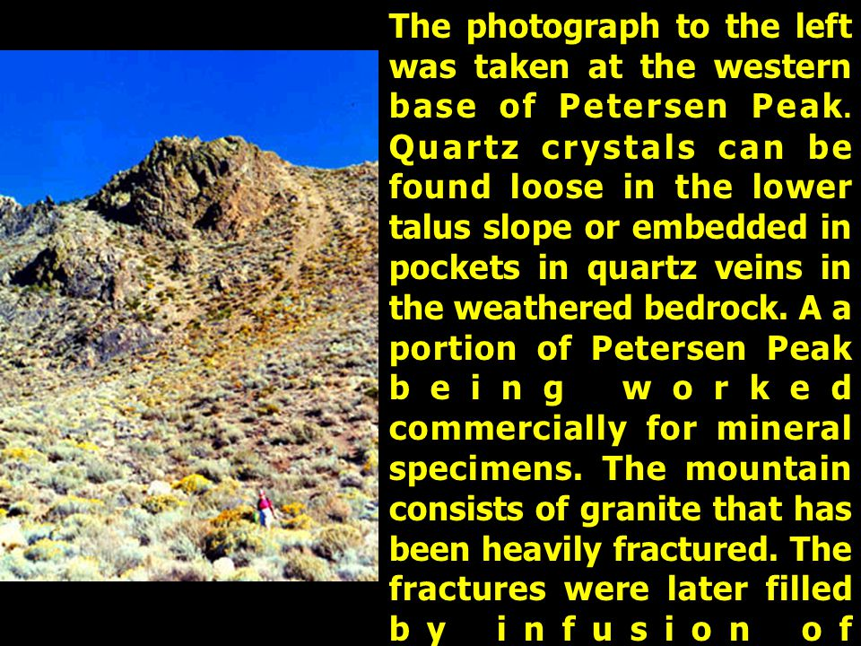 The photograph to the left was taken at the western base of Petersen Peak. Quartz crystals can be found loose in the lower talus slope or embedded in
