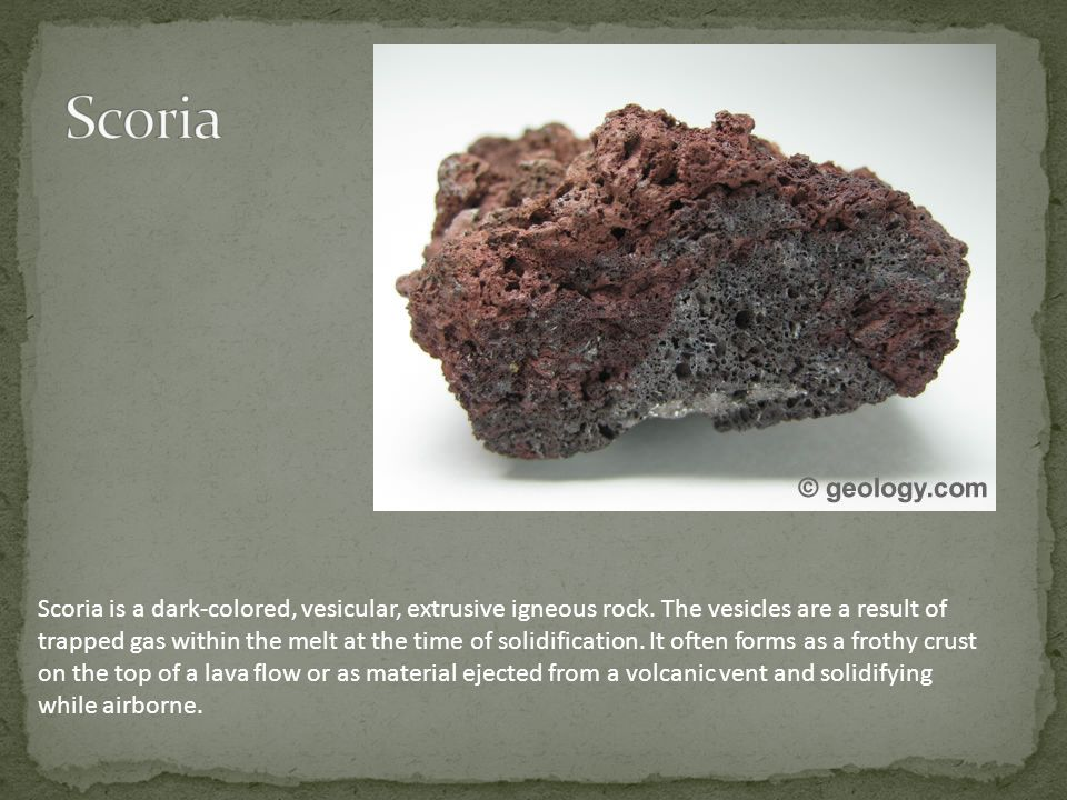 Scoria is a dark-colored, vesicular, extrusive igneous rock. The vesicles are a result of trapped gas within the melt at the time of solidification. I